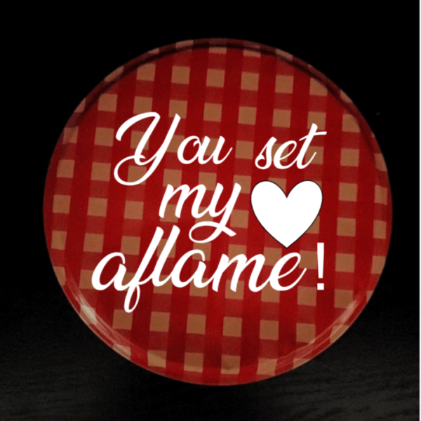 """Valentine's Day Fire Starter top view. Red plaid tin lid with words """"You Set My Heart Aflame"""""""