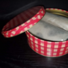 Valentine's Day Fire Starter Side View: Shows red plaid tin open to reveal two fire starters.