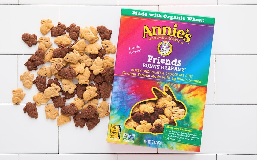 Box of Annie's Bunny Grahams in a Tie Dye Box with a pile of variety bunny grahams beside it.
